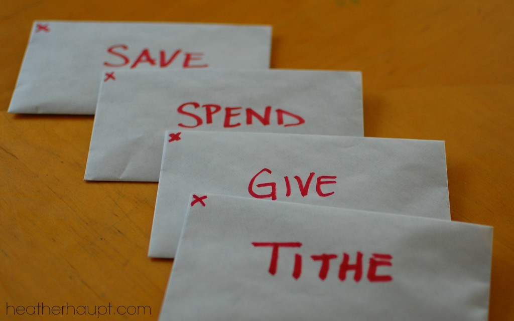 Using the envelope system is a great way to help kids understand finances.