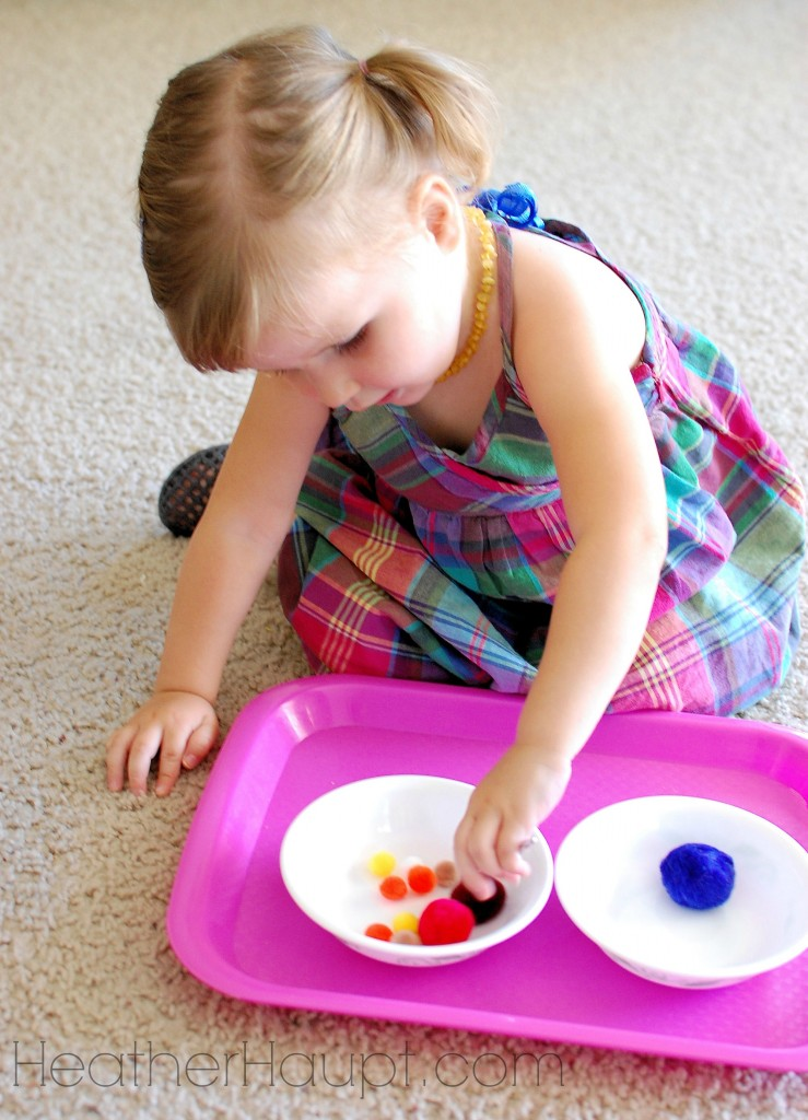 Fine-Motor skills honed when moving puff balls from one bowl to another.